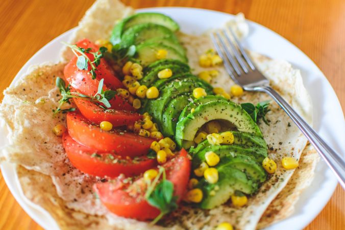 sliced-tomato-and-avocado-on-white-plate-1143754